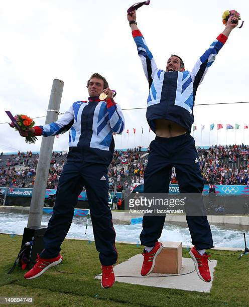 Tim Baillie and Etienne Stott of Great Britain pose with their gold medals during the medal ceremony after the Men's Canoe Double Slalom final on Day...