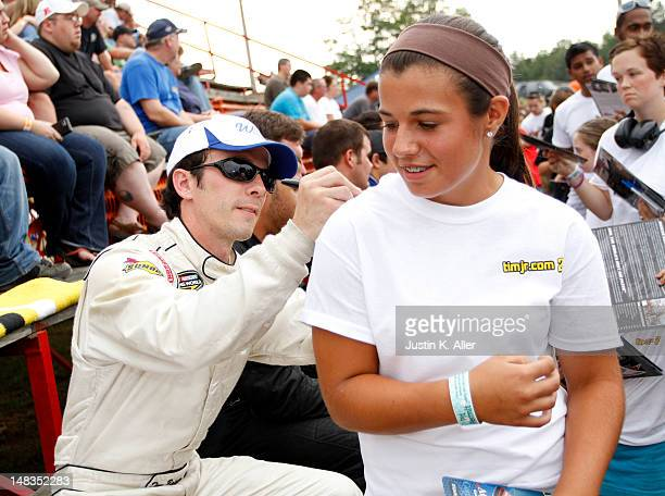 Tim Bainey driver of the Window World/DelGrosso Chevrolet signs autographs during the NASCAR KN Pro Series East Samuel 150 on July 14 2012 at CNB...