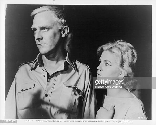 Tim Barrett and Beba Loncar watch for the police in a scene from the film 'The Boy Cried Murder' 1966