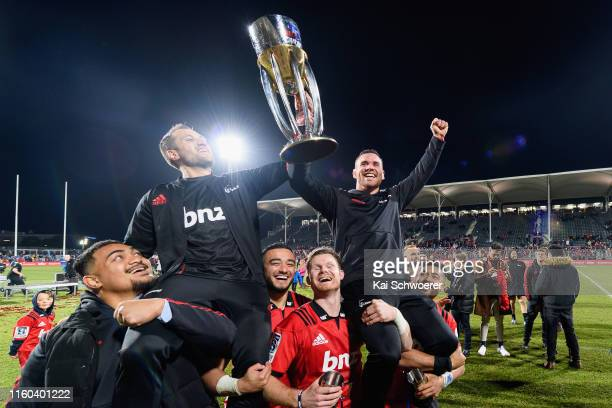 Tim Bateman and Ryan Crotty of the Crusaders lift the Super Rugby trophy after winning the Super Rugby Final between the Crusaders and the Jaguares...