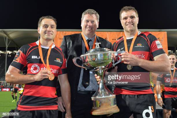 Tim Bateman of Canterbury Head Coach Glenn Delaney of Canterbury and Luke Whitelock of Canterbury celebrate with the Rugby Cup after their win in the...