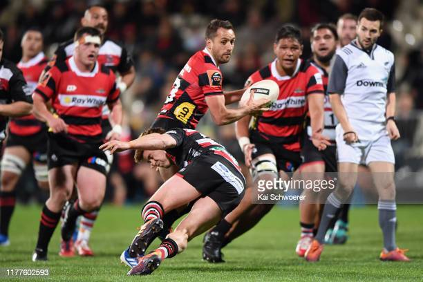 Tim Bateman of Canterbury offloads the ball during the round 8 Mitre 10 Cup match between Canterbury and Counties Manukau at Orangetheory Stadium on...