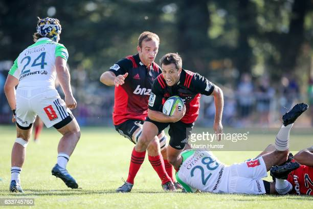 Tim Bateman of the Crusaders breaks out of a tackle during the preseason Super Rugby match between the Crusaders and the Highlanders on February 4...