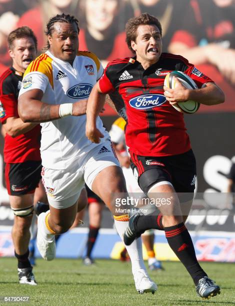 Tim Bateman of the Crusaders makes a break to score a try during the round one Super 14 match between the Crusaders and the Chiefs at AMI Stadium on...