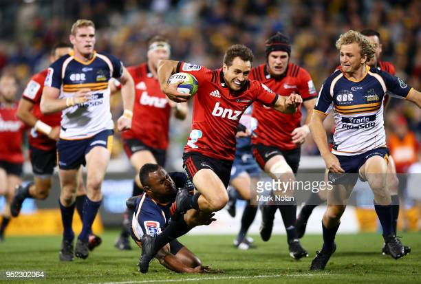 Tim Bateman of the Crusaders makes a line break to score during the round 11 Super Rugby match between the Brumbies and the Crusaders at GIO Stadium...