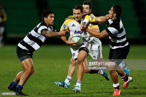 Tim Bateman of the Hurricanes attempts to beat the Hawkes Bay defence during the match between the Hurricanes and Hawkes Bay at FMG Stadium on June...