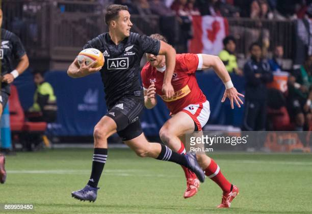 Tim Bateman of the Maori All Blacks tires to out run Dan Moor of Canada during an international rugby friendly match at BC Place on November 3, 2017...