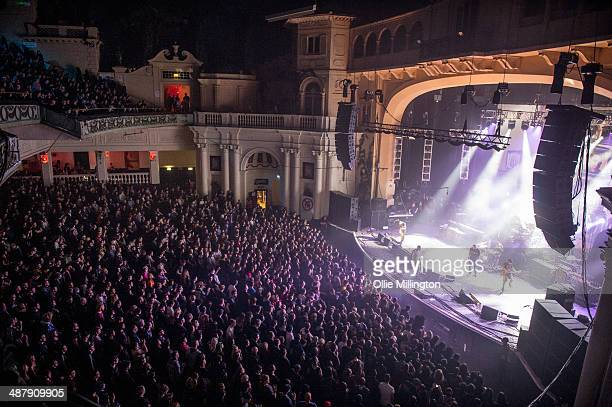 Tim Beazley Jermaine J Hurley Ben Marvin Richard Hawking and Josh Gurner of Hactivist perform on stage at Brixton Academy on May 2 2014 in London...