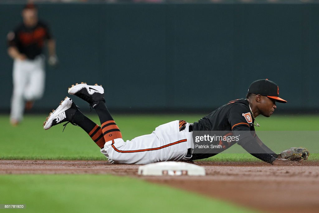 Tim Beckham #1 of the Baltimore Orioles cannot make a play on a hit by Steven Souza Jr. #20 of the Tampa Bay Rays (not pictured) during the second inning at Oriole Park at Camden Yards on September 22, 2017 in Baltimore, Maryland.