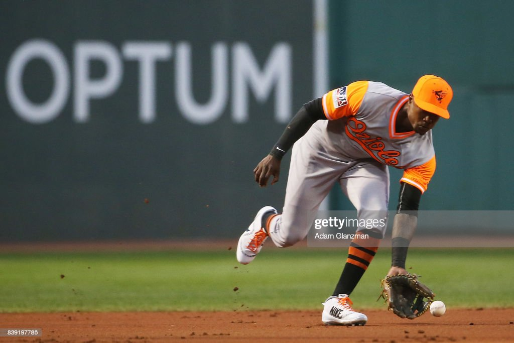 Tim Beckham #1 of the Baltimore Orioles fields a ground ball in the first inning of a game against the Boston Red Sox at Fenway Park on August 25, 2017 in Boston, Massachusetts.