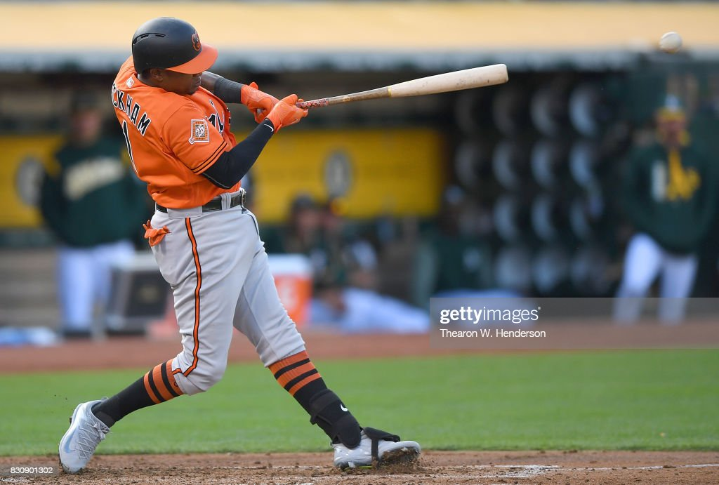 Tim Beckham #1 of the Baltimore Orioles in his second at bat of the first inning hits a two-run rbi double against the Oakland Athletics at Oakland Alameda Coliseum on August 12, 2017 in Oakland, California.