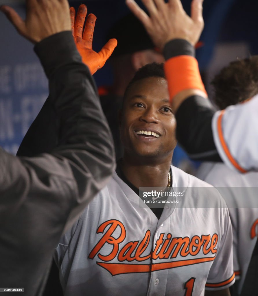 Tim Beckham #1 of the Baltimore Orioles is congratulated by teammates in the dugout after hitting a solo home run in the eighth inning during MLB game action against the Toronto Blue Jays at Rogers Centre on September 12, 2017 in Toronto, Canada.