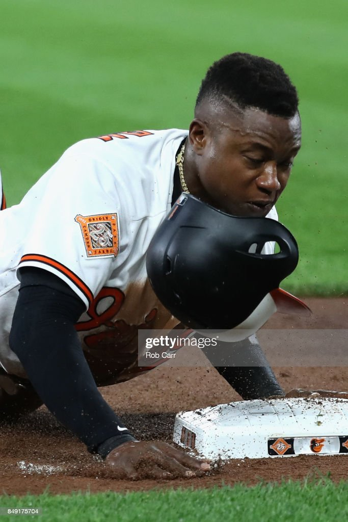 Tim Beckham #1 of the Baltimore Orioles slides safley into third base against the Boston Red Sox in the first inning at Oriole Park at Camden Yards on September 18, 2017 in Baltimore, Maryland.