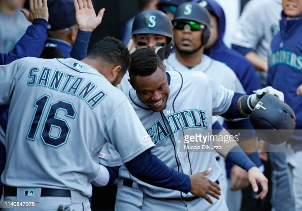 Tim Beckham of the Seattle Mariners celebrates his threerun home run with Domingo Santana in the fifth inning during the game against the Chicago...