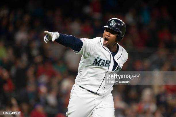 Tim Beckham of the Seattle Mariners points to the dugout after hitting what would be a pinchhit gamewinning home run in the eighth inning against the...
