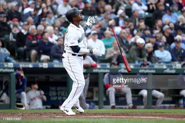 Tim Beckham of the Seattle Mariners reacts after hitting a solo home run against the Boston Red Sox in the second inning during their Opening Day...