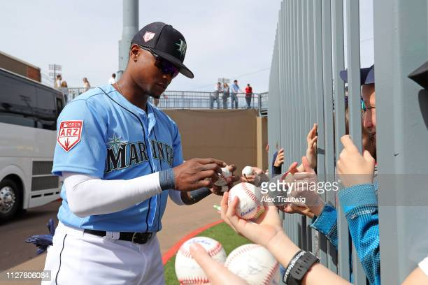 Tim Beckham of the Seattle Mariners signs autographs ahead of a Spring Training game against the Cincinnati Reds on Monday February 25 2019 at Peoria...