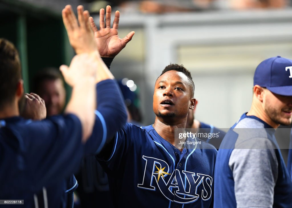 Tim Beckham #1 of the Tampa Bay Rays celebrates with teammates after scoring during the eighth inning against the Pittsburgh Pirates at PNC Park on June 27, 2017 in Pittsburgh, Pennsylvania.