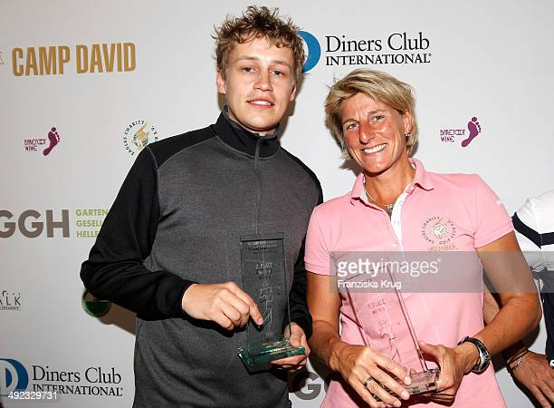 Tim Bendzko and Silke Rottenberg attend the 'Camp David Eagles Hauptstadt Golf Cup' on May 19 2014 in Berlin Germany