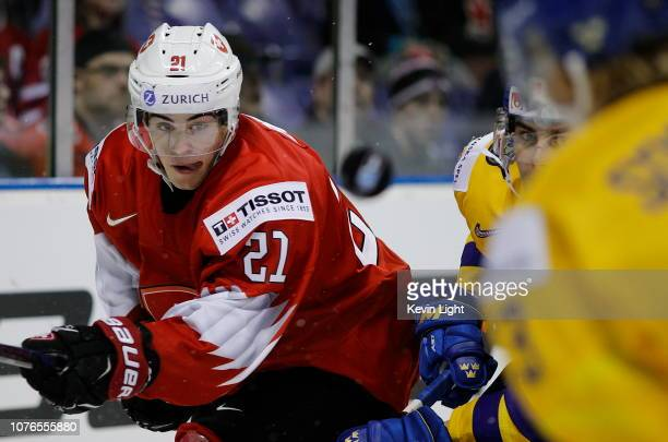 Tim Berni of Switzerland clears the puck versus Sweden during a quarter-final game at the IIHF World Junior Championships at the Save-on-Foods...