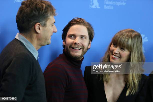 Tim Bevan Daniel Bruehl and Rosamund Pike pose at the '7 Days in Entebbe' photo call during the 68th Berlinale International Film Festival Berlin at...
