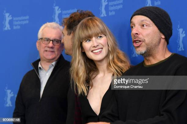 Tim Bevan Rosamund Pike and Jose Padilha pose at the '7 Days in Entebbe' photo call during the 68th Berlinale International Film Festival Berlin at...