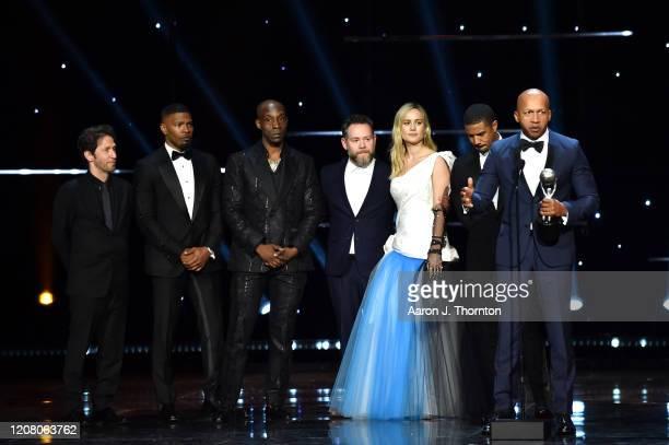 Tim Blake Nelson Jamie Foxx Rob Morgan producer Asher Goldstein Brie Larson Michael B Jordan and writer Bryan Stevenson accept the Outstanding Motion...