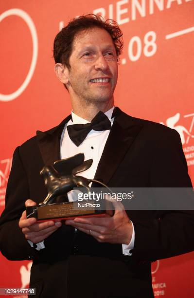 Tim Blake Nelson poses with the Best Screenplay Award for 'The Ballad Of Buster Scruggs ' at the Winners Photocall during the 75th Venice Film...