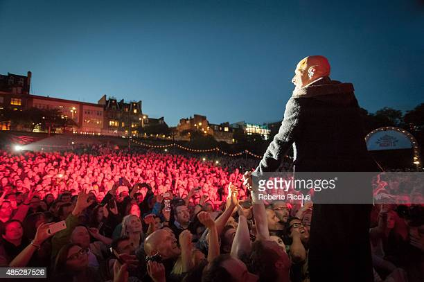 Tim Booth of James performs on stage during Magners Summer Nights at Princes Street Gardens on August 26 2015 in Edinburgh Scotland