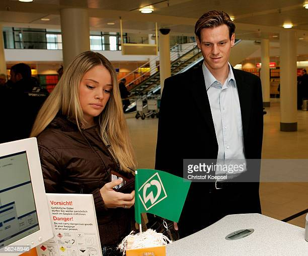 Tim Borowski and his girlfriend Lena Muehlbacher check in at the Bremen airport before leaving for Barcelona Spain on November 21 2005 in Bremen...