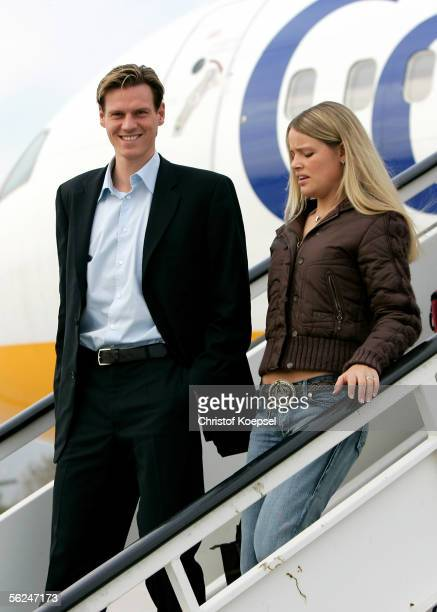 Tim Borowski and his girlfriend Lena Muehlbacher deplane after landing on November 21 2005 in Barcelona Spain The match between FC Barcelona and...