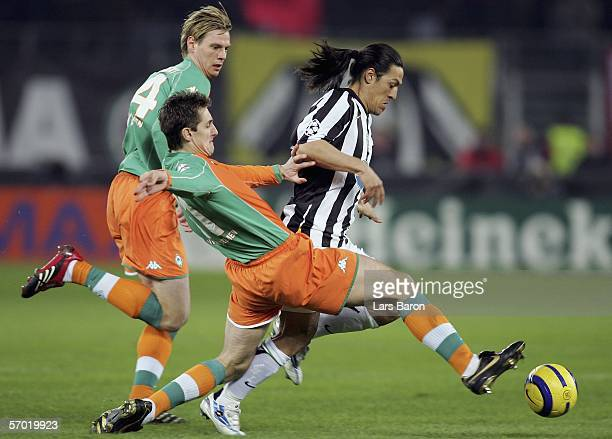 Tim Borowski and Miroslav Klose of Bremen challenge Mauro Camoranesi of Turin for the ball during the UEFA Champions League Round of 16 Second Leg...