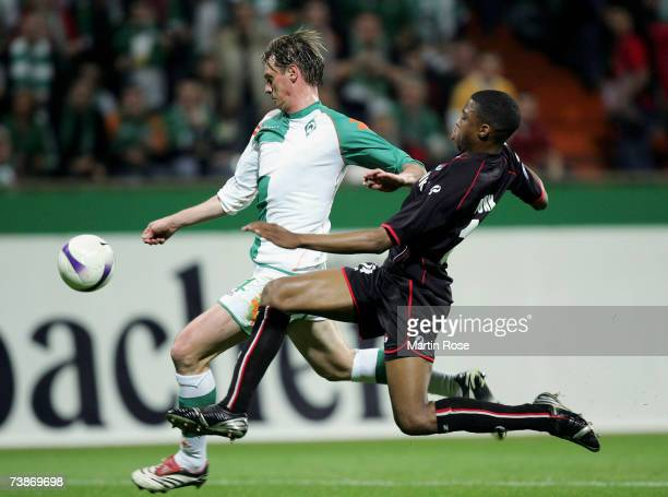 Tim Borowski of Bremen and Kew Jaliens of Alkmaar fight for the ball during the UEFA Cup second leg quarter final match between Werder Bremen and AZ...