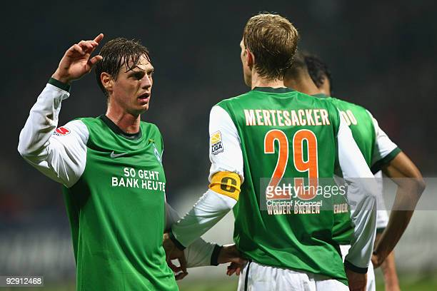 Tim Borowski of Bremen issues instructions to the team during the Bundesliga match between SV Werder Bremen and Borussia Dortmund at the Weser...