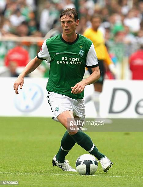 Tim Borowski of Bremen runs with the ball during the Bundesliga match between Werder Bremen and Eintracht Frankfurt at the Weser stadium on August 8...