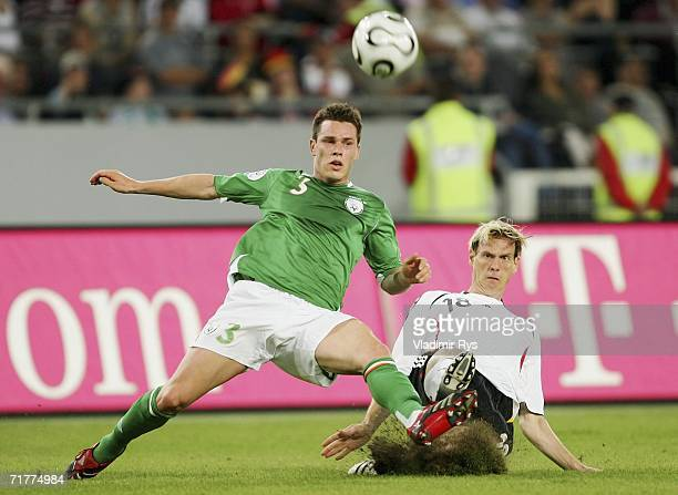 Tim Borowski of Germany and Steve Finnan of Ireland battle for the ball during the Euro 2008 qualifying match between Germany and the Republic of...