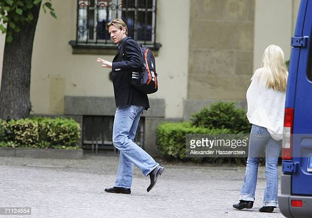 Tim Borowski of Germany arrives with his girlfriend Lena Muehlbacher at the team hotel Schlosshotel Grunewald on June 5 2006 in Berlin Germany...