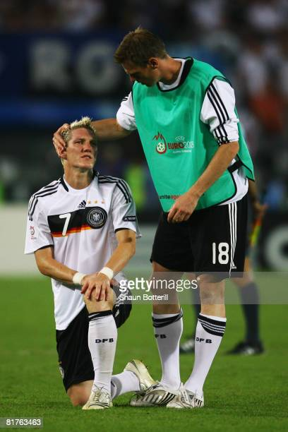 Tim Borowski of Germany comforts Bastian Schweinsteiger after the UEFA EURO 2008 Final match between Germany and Spain at Ernst Happel Stadion on...