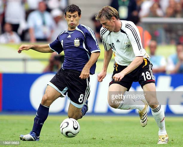 Tim Borowski of Germany tries to get around Javier Mascherano of Argentina during their quarterfinal match at the Olympiastadion in Berlin Germany on...