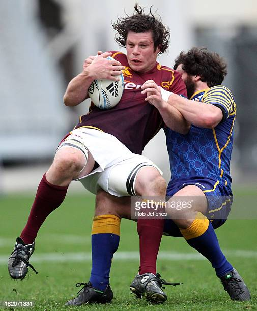Tim Boys of Southland is wrapped up by Kieran Moffat of Otago during the round seven ITM Cup match between Otago and Southland at Forsyth Barr...