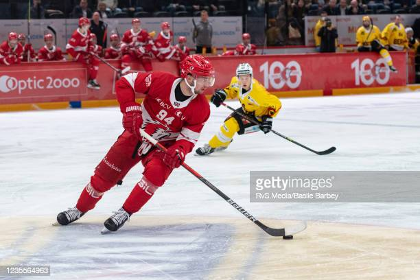 Tim Bozon of Lausanne HC carries the puck in front of Dominik Kahun of SC Bern during the Swiss National League game between Lausanne HC and SC Bern...