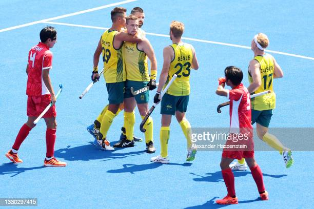 Tim Brand of Team Australia celebrates with teammates after scoring against Japan during the Men's Pool A match on day one of the Tokyo 2020 Olympic...