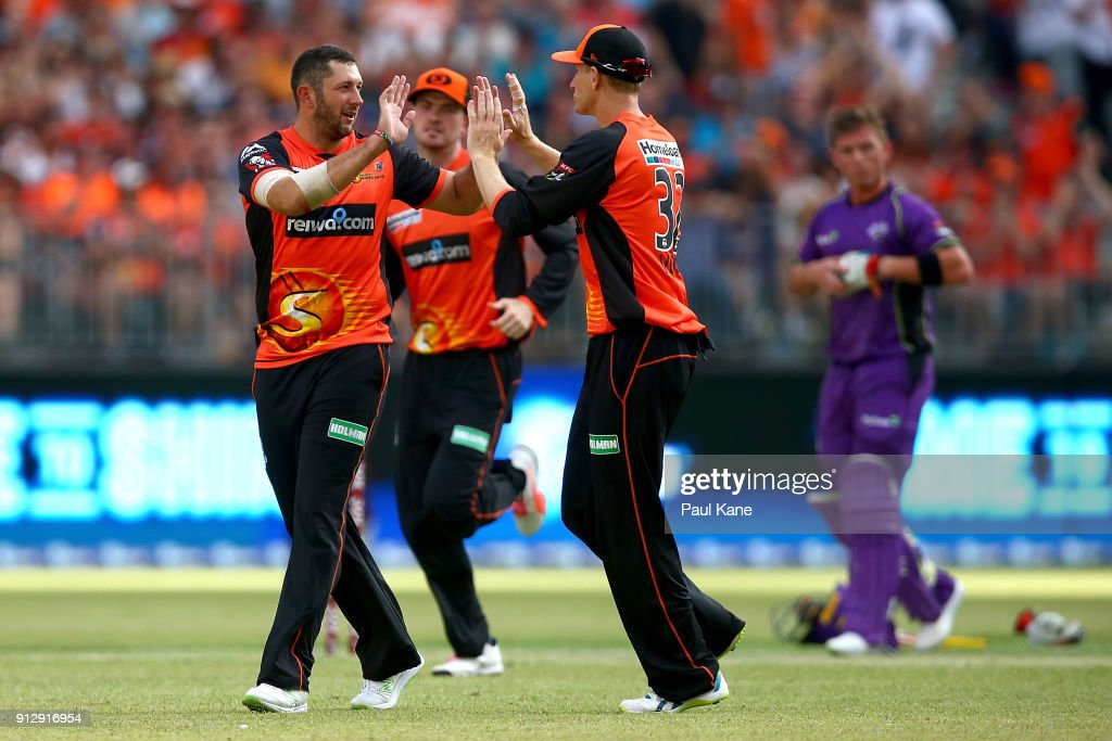 Tim Bresnan and Adam Voges of the Scorchers celebrate the wicket of Matthew Wade of the Hurricanes during the Big Bash League Semi Final match between the Perth Scorchers and the Hobart Hurricanes at Optus Stadium on February 1, 2018 in Perth, Australia.