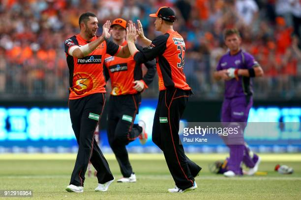 Tim Bresnan and Adam Voges of the Scorchers celebrate the wicket of Matthew Wade of the Hurricanes during the Big Bash League Semi Final match...