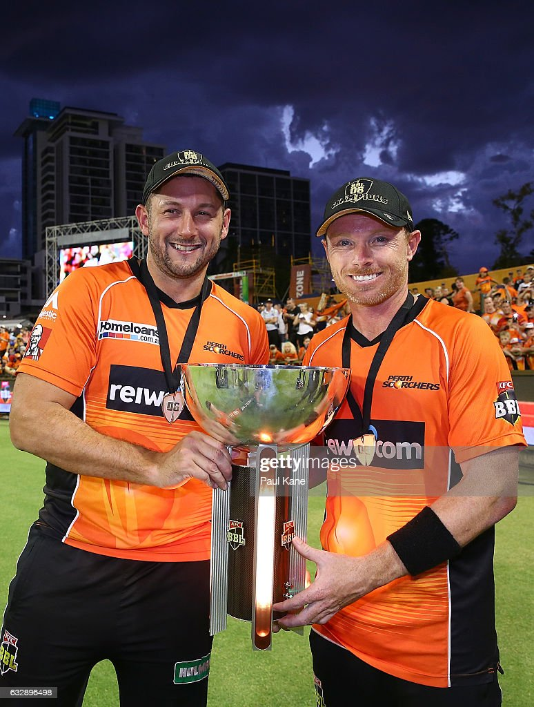 Tim Bresnan and Ian Bell of the Scorchers hold the BBL trophy after winning the Big Bash League match between the Perth Scorchers and the Sydney Sixers at WACA on January 28, 2017 in Perth, Australia.