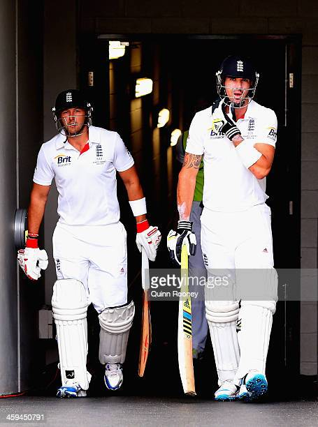Tim Bresnan and Kevin Pietersen of England walk out onto the field to start play on day two of the Fourth Ashes Test Match between Australia and...