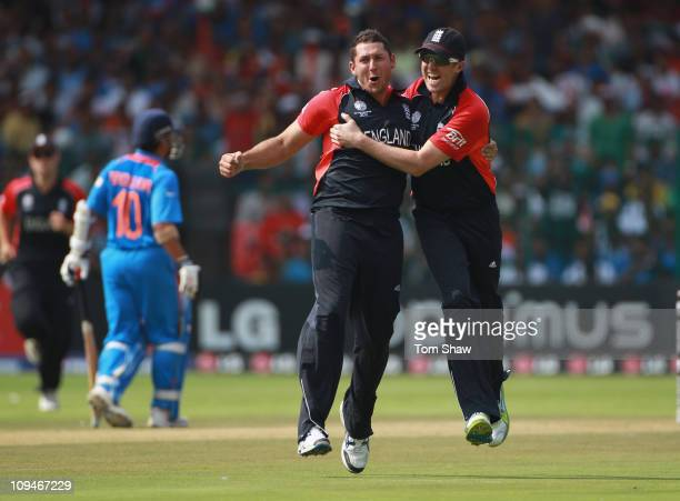 Tim Bresnan of England celebrates with Graeme Swann of England after taking the wicket of Virender Sehwag of India during the 2011 ICC World Cup...
