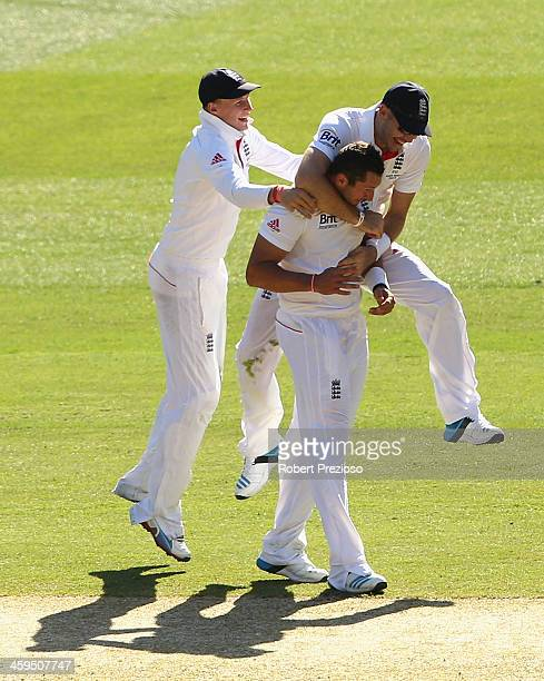 Tim Bresnan of England is congratulated by team mates after taking the wicket of Mitchell Johnson of Australia during day two of the Fourth Ashes...