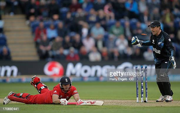 Tim Bresnan of England is run out as New Zealand wicketkeeper Luke Ronchi celebrates during the ICC Champions Trophy group A match between England...