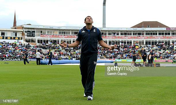 Tim Bresnan of England looks to the skies as rain delays the start of the 3rd Natwest One Day International match between England and Australia at...